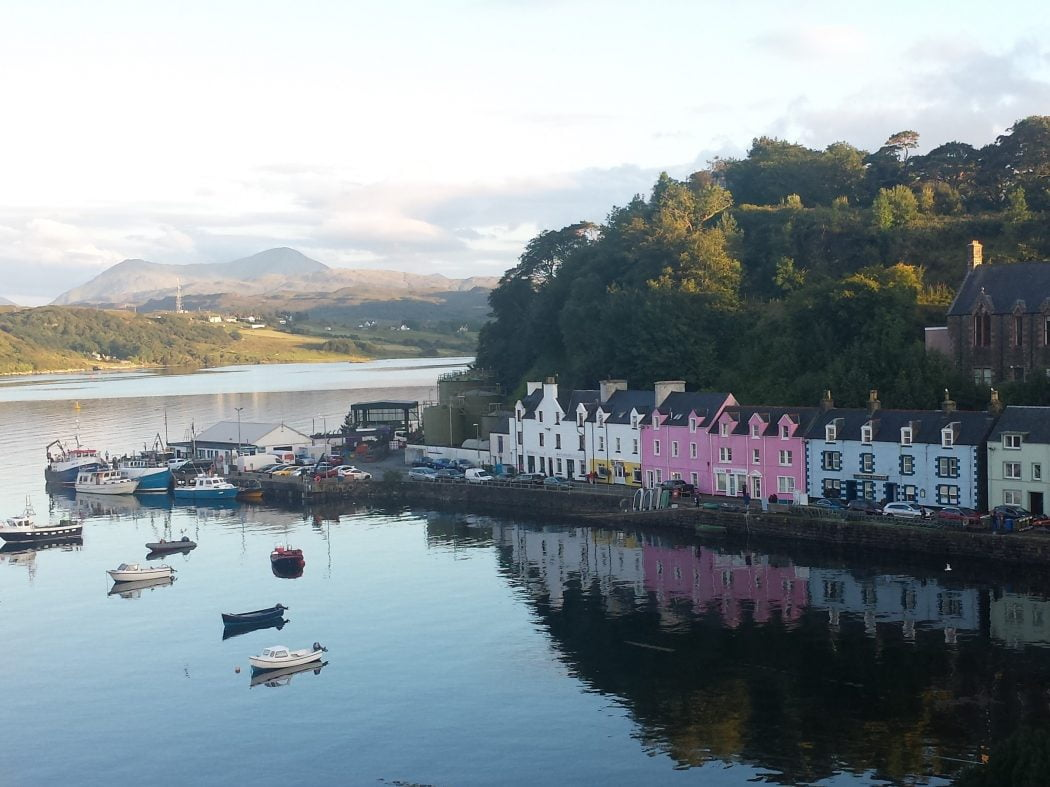 A line of brightly painted houses of different colours, along the harbour side in Portree on our Isle of Skye and Dunvegan Castle Tour