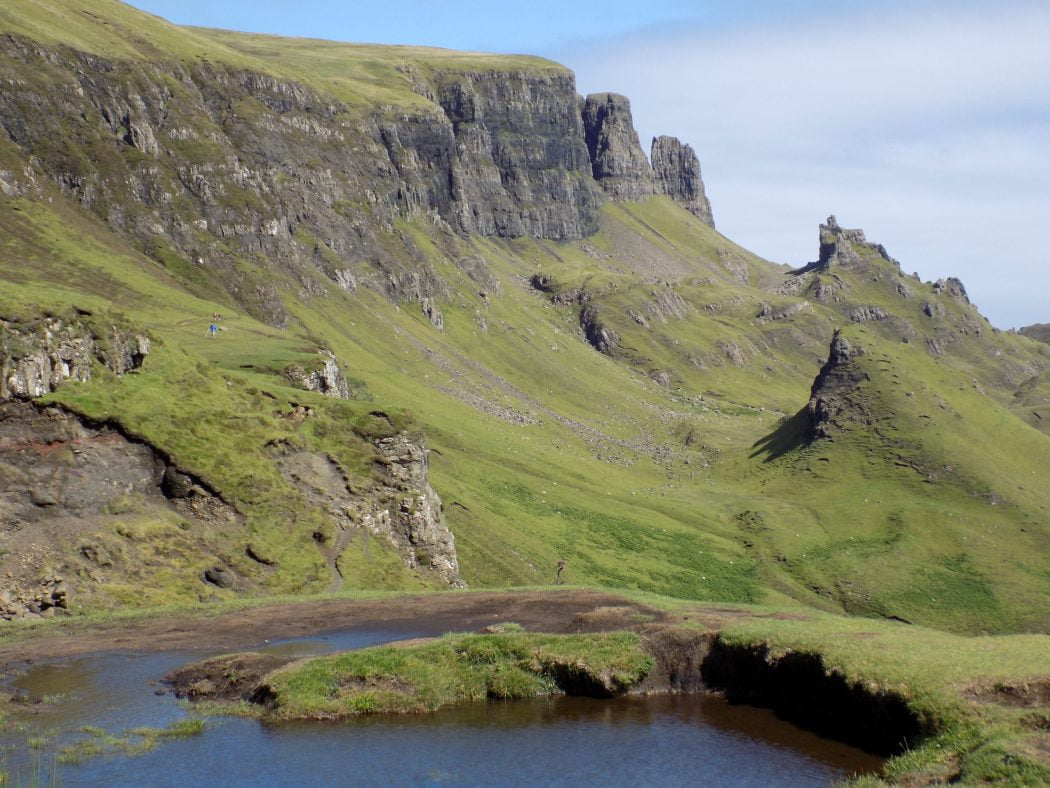 Picture of hill top scenery at a location on the Isle of Skye called the Quiraing. The picture shows a geological landslip feature with spires and pinnacles