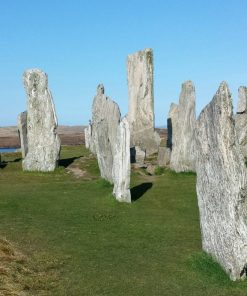 Standing Stones of Callanish in bright sunshine with blue sky taken on our Hebrides – Two Day Tour