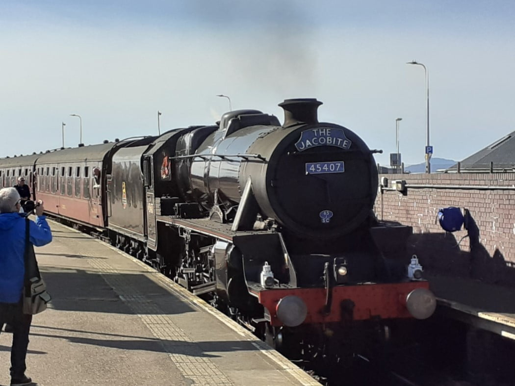 This picture is the Jacobite Train pulled in at Mallaig on our Isle of Skye and Hogwarts Express Tour. You can see the steam engine, the tender and the first two carriages. The rest of the train is out of shot to the left.